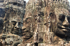 Stone carves in temple of. Beautiful temples in Angkor wat area are really beautiful with wonderful architecture. Bayon face Royalty Free Stock Photography