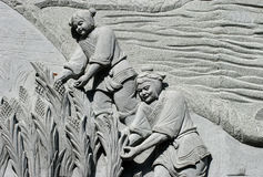 Stone carving 06. Stone carving ,two persons Royalty Free Stock Images