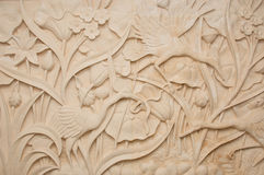 Stone Carving. A tropical flora and cane theme stone carving stock image
