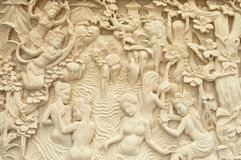 Stone Carving. A stone carving with goddess and woman bathing theme royalty free stock photography