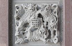 Stone carving. Dragon-headed unicorn Royalty Free Stock Photos