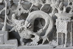 Stone carving. Dragon-headed unicorn Stock Photography