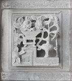 Stone carving. Dragon-headed unicorn Stock Images