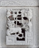 Stone carving. Dragon-headed unicorn Royalty Free Stock Images