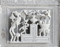 Stone carving. Dragon-headed unicorn Royalty Free Stock Image