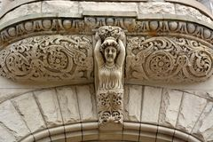 Stone carving above entrance stock images