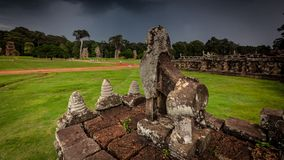 Stone carving of Angkor ruin with stormy sky Royalty Free Stock Photo