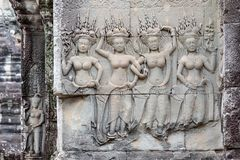 Stone carving of Apsaras on a wall, Angkor Wat, Siem Reap, Cambodia, Asia stock photo