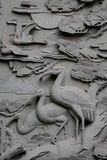 Stone carving of cranes Stock Image