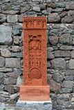 Stone carving with a cross. Red stone carving with a cross (khachkar) in Geghard, Armenia royalty free stock photo