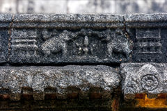 A stone carving depicting two elephants on the image house (gedige) at Nalanda Gedige near Matale in Sri Lanka. A stone carving depicting two elephants on the Stock Photo