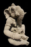 Stone carving elephant. A statue of stone carving elephant - Ganesh, isolated on black background Royalty Free Stock Images