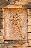 Stone carving of flowers on brick wall texture background. Stone carving of flowers on brick wall texture Stock Photography