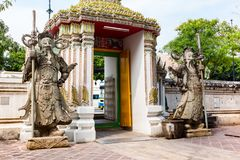 Stone carving giants infront of the gate of Wat Pho in Bangkok. Thailand Stock Images