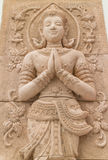 Stone carving for greeting and smile deva statue Stock Photos
