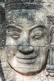 Stone carving. Of a human face. Asian Art Royalty Free Stock Image