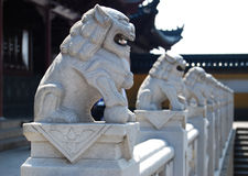 Stone carving lion. China's manual chiseled stone lions Stock Photo