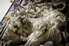 Stone carving of lion and warrior Royalty Free Stock Image