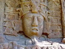 Stone carving in the Mayan ruins on the Caribbean coast of Mexico stock photography