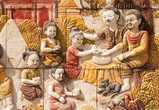 Stone carving of Thai culture of Songkran festival Royalty Free Stock Photography