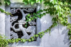 Stone carving of a tree as decoration for a window in a wall in China. Near Beijing royalty free stock photos