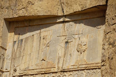 Stone carvings in bas-relief on the Tomb of Xerxes I at Persepol Stock Images