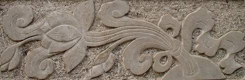 The stone carvings , the graceful flowers Royalty Free Stock Photos