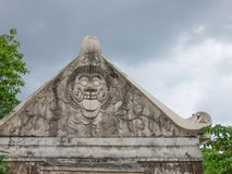Stone carvings on a historical building in Yogyakarta. Java, Indonesia. Traditional Javanese style stone carvings with a Hindu motives Stock Photos