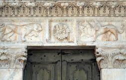 Stone carvings on the portal of Santa Maria Forisportam church in Lucca, Italy. Stone carvings on the portal of Santa Maria Forisportam church in Lucca, Tuscany Stock Photo