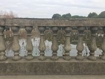 Stone carving railings. Stone carvings on a stone bridge with a sequence of patterns Stock Photo
