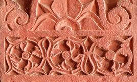 Stone carvings on the wall in Fatehpur Sikri. Beautiful stone carvings on the wall in Fatehpur Sikri complex, Uttar Pradesh, India Royalty Free Stock Photo