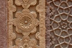 Stone carvings on the wall of a temple in India Royalty Free Stock Images