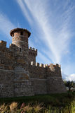 Stone Castle. A stone castle with hilly mountains in the background Royalty Free Stock Photography