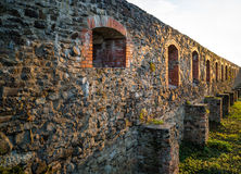 Stone castle wall with embrasure. Stock Photo