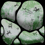 Stone cave art. Ancient wild animals, hunting scenes depicted on stones Royalty Free Stock Images