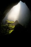 Stone Cave With Sunlight Stock Photos