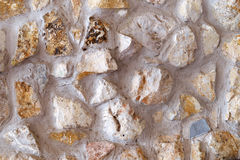 The stone in cement wall textured background Stock Photography