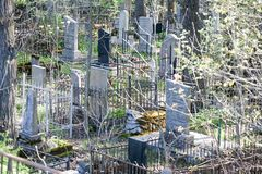 Stone cemetery grave monuments closeup view. On spring outdoor background royalty free stock image