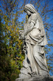Stone cemetery statue Stock Images