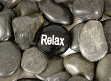 Stone In Center Saying 'Relax' For Encouragement Royalty Free Stock Photography