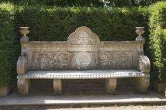 Stone Chair. Within the gardens of a large english stately home royalty free stock photos