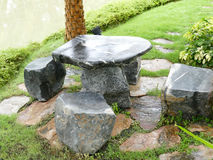 Stone chair and desk in the garden Stock Photo