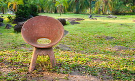 Stone chair in the garden Royalty Free Stock Image