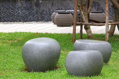 Stone chair in park. Stone chair in condo park Royalty Free Stock Photos