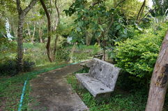 A stone chair of relaxing corner in the park Royalty Free Stock Photos