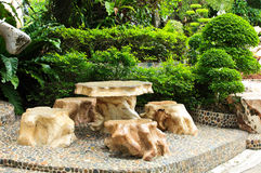 Stone chair and table in the garden. Royalty Free Stock Images