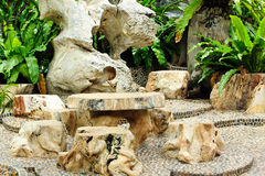 Stone chair and table in the garden Royalty Free Stock Images