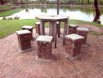 Stone chairs and round eight table. Royalty Free Stock Photos