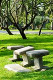 Stone chairs standing on the garden Royalty Free Stock Photography