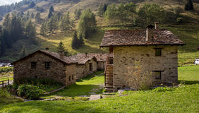 Stone chalets in a tiny mountaing village. Case di Viso - Ponte Stock Images